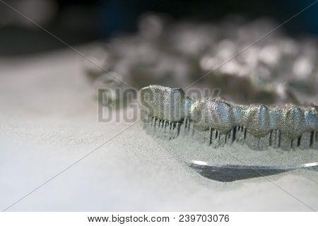Object Printed On Metal 3d Printer, Laser Sintering Machine For Metal Close-up. Metal Dental Crowns