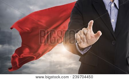 Confident Business Superhero Man Wearing Red Cape Against With City Background. Concept Point To Fut
