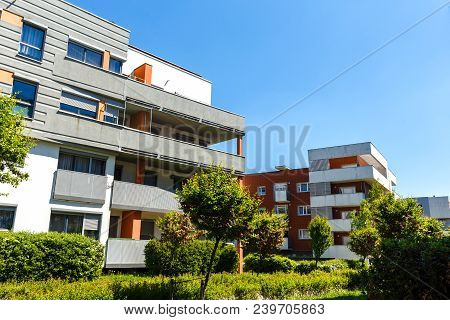 Exterior Of A Modern  Apartment Buildings On A Blue Sky Background. No People.  Real Estate Business