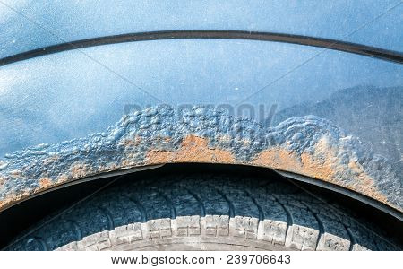 Damaged Corroded Blue Car With Scratched Paint And Rust Close Up