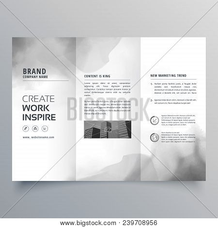trifold brochure with black ink stain design poster
