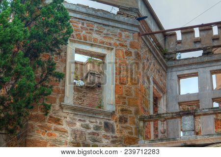 Wall And Window Gap Of The Facade Of The Abandoned Old Mansion Called Dacha Kvitko In Overcast Day,