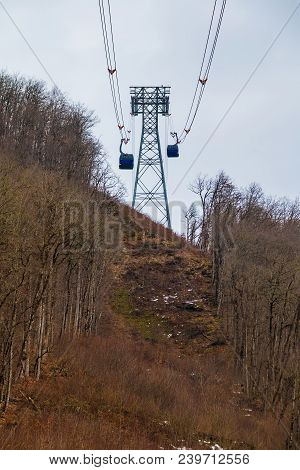 Two Cabins And Pylon Of The Cableway Over The Mountainside With Bare Trees In Winter Day, Krasnaya P