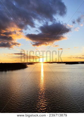 Aerial View Of A Sunset Sky Background. Aerial Dramatic Gold Sunset Sky With Evening Sky Clouds Over