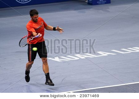 BUKIT JALIL, MALAYSIA- OCT 01:Serbia's Janko Tipsarevic (third seeded) hits a return in his Malaysian Open semi-final win over Japan's Kei Nishikori on October 01, 2011 in Putra Stadium, Bukit Jalil, Malaysia.