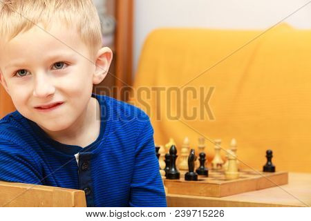 Intelligent, Smart Ass Kids, Games Good For Brain Intelligence Concept. Young Kid Boy Playing Chess
