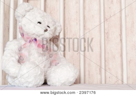 Teddy Bear Sitting In The Cot