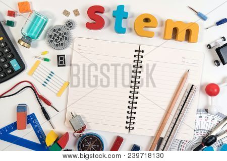 Stem Education. Science Technology Engineering Mathematics. Stem Word On Book With Education Equipme