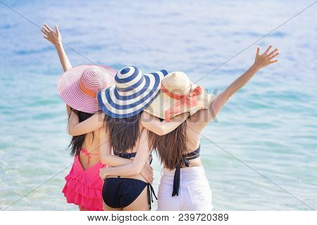 Summer Lifestyle Of Three Women Friends Having Fun And Happy On Beach. Positive Emotions. Summer Con