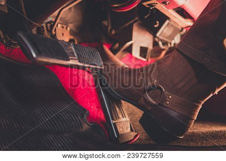 Cowboy Pushing The Accelerator Using Cowboy Boot. Wild West Pedal To The Metal Theme. Classic Car Au