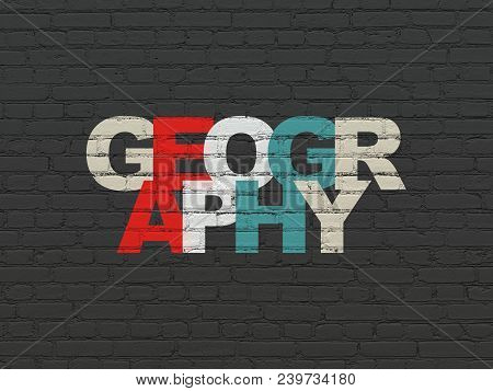 Studying Concept: Painted Multicolor Text Geography On Black Brick Wall Background