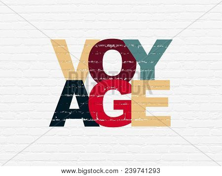 Travel Concept: Painted Multicolor Text Voyage On White Brick Wall Background