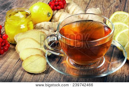 Tea For Cold And Flu. Vitamin Tea, Lemon, Ginger, Kiwi Fruit, And Viburnum For Tea For A Cold. Drink