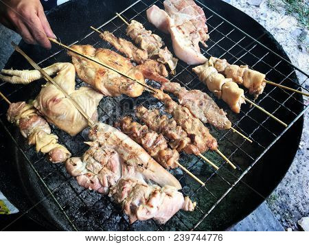Thai Street Food : Charcoal Grilled Roast Chickens, Pork On The Stove Half Cut Oil Tank With Smoke.