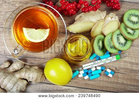 Tea For Cold And Flu. Vitamin Tea, Honey, Lemons And Viburnum, Thermometer And Tablets. Medicines Fo