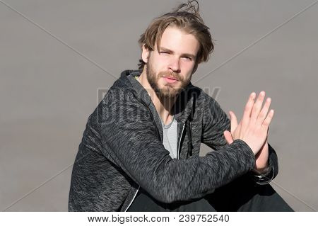 Bearded Man With Long Blond Hair Outdoor. Macho With Beard In Casual Sportswear On Sunny Day. Fashio