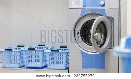 Washing Machine And Laundry Baskets In The Self Service Laundry