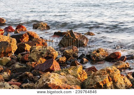 Long Exposure Of Sea And Rocks, Sunset Over The Sea , Long Exposure Of The Wave During Sunset On The