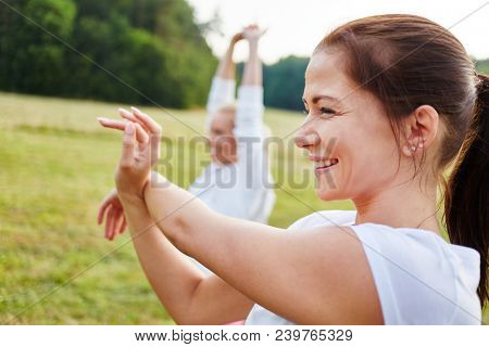 Vital women stretching with joy and working out