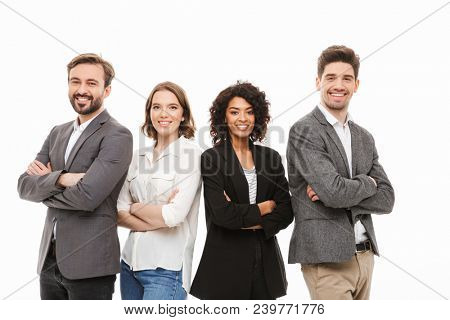 Group of happy multiracial business people standing with arms folded isolated over white background