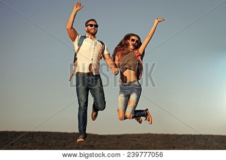 Happy Couple In Love Jump On Blue Sky, Wanderlust. Woman And Man Smile On Summer Vacation. Couple, L