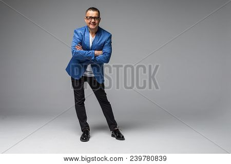 Full Length Portrait Of Confident Mature Businessman In Formals Standing Isolated Over White