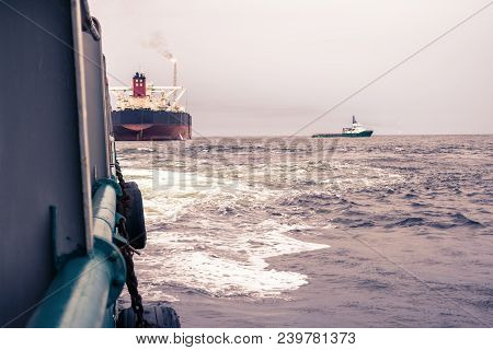 Anchor-handling Tug Supply Ahts Vessel At Work With Fpso Tanker. Vessel Is Doing Static Tow Tanker L