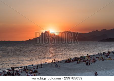 Orange Sunset By The Ocean In Piratininga, Niteri, With Sun Dipping Behing The Gavea Stone In Rio De
