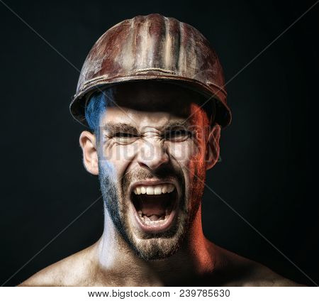 Portrait Of Screaming Bearded Handsome Male Builder, Closeup. Portrait Bearded Man With Protect Helm