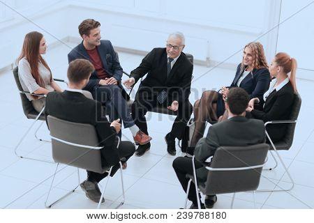 Businessman Leading Meeting At Boardroom