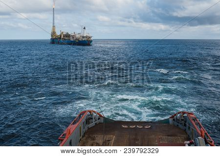 Anchor-handling Tug Supply Ahts Vessel During Dynamic Positioning Dp Operations Near Fpso Tanker. Ve