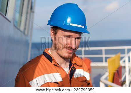Marine Deck Officer Or Chief Mate On Deck Of Vessel Or Ship , Wearing Ppe Personal Protective Equipm
