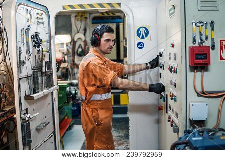 Marine Engineer Officer Controlling Vessel Engines And Propulsion In Engine Control Room Ecr. Ship M