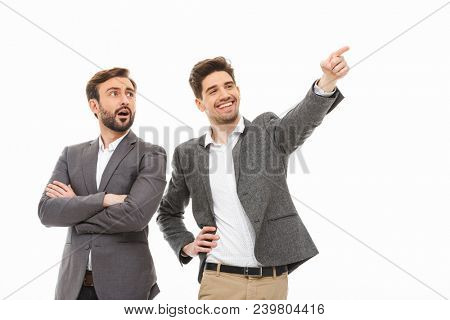 Portrait of a two excited business men looking away isolated over white background