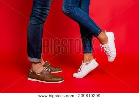 Closeup Photo Of Woman And Man Legs In Jeans, Pants And Shoes, Girl With Raised Leg, Stylish Couple