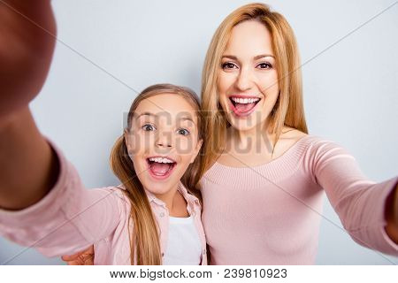 Self Portrait Of Crazy, Foolish Mother And Daughter With Open Mouth, Laughing, Together Making Selfi