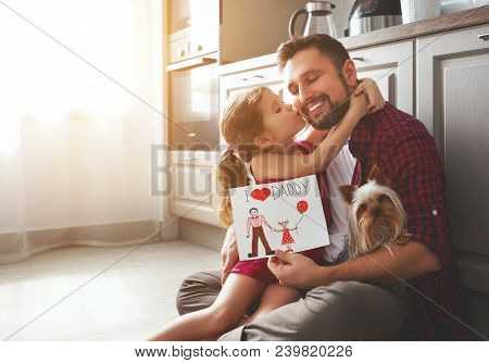 Father's Day. Happy Family Daughter Giving Dad Greeting Card