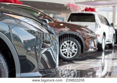 Car Auto Dealership. Themed Blur Background With Bokeh Effect. New Cars At Dealer Showroom. Prestigi