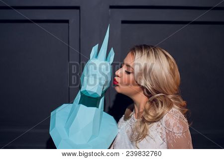 Freaky Blonde Girl In Sunglasses And Kitty Ears With Funny Guy In Horse Head Mask On The Purple Back