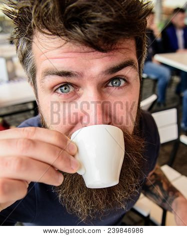 Guy Having Rest With Espresso Coffee. Coffee Break Concept. Hipster On Calm Face Drinking Coffee Out