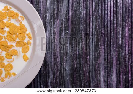 Corn Flakes With Milk. Plate On A Wooden Background. White Dish With Flakes. Yellow Flakes. Salvage