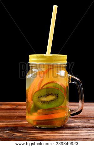 Infused Water With Kiwi And Orange In Jar