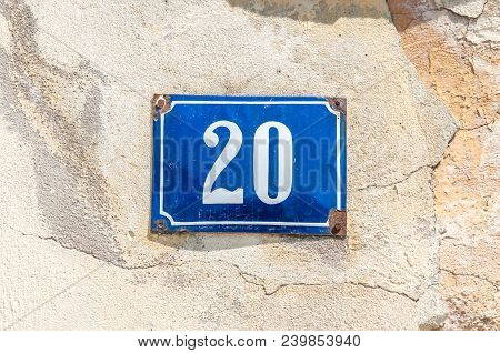 Old Vintage House Address Metal Number 20 Twenty On The Plaster Facade Of Abandoned Home Exterior Wa