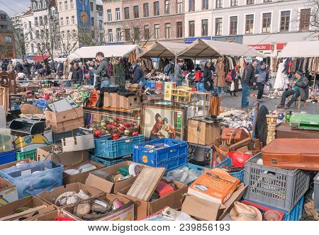 Brussels, Belgium - Apr 3: Buyers Of Flea Market Looking For Bargains And Antique Stuff In Mess Of V