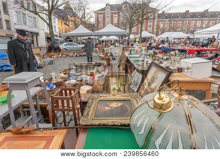 Brussels, Belgium - Apr 3: Customer Of Flea Market And Many Old Art, Bargains And Antique Stuff In M