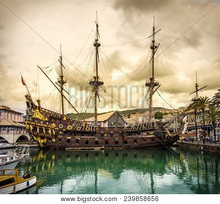 Pirate Sailing Ship Galleon Sailer In The Port Of Genoa Under A Yellow Storm Cloudscape - Liguria -