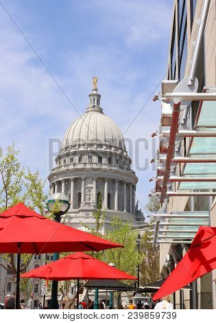 Sunny Spring Day Street View With State Capitol Building And Outdoor Cafe Bright Red Umbrellas On A