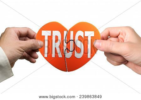 Man And Woman Two Hands Assembling Heart Shaped Puzzle Pieces With Word Trust, Isolated On White Bac