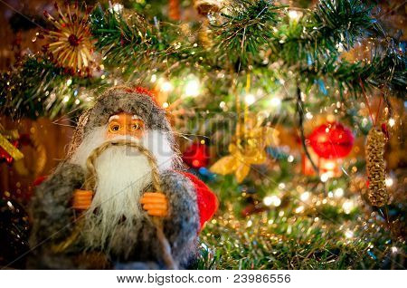 Santa Claus underneath the Christmas tree