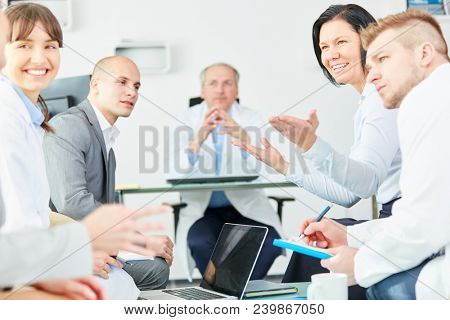 Clinic employee staff in a meeting discuss medical information in teamwork